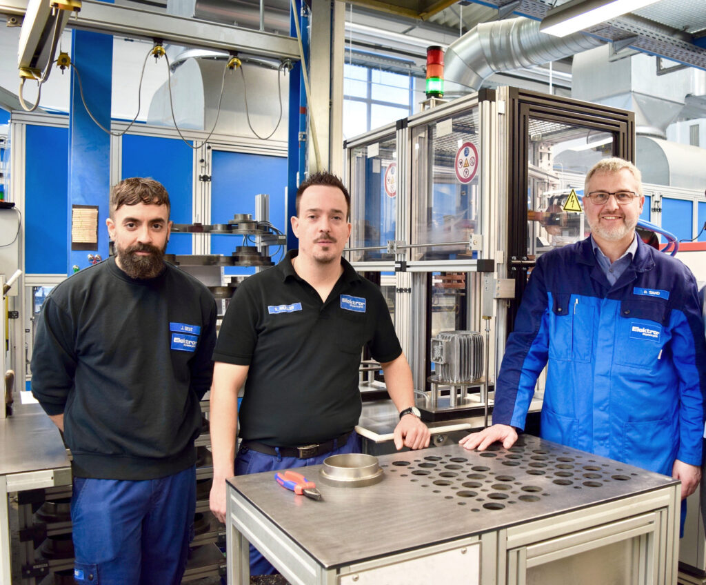 John Best, Head of Motor Engineering team at Elektror, Steffen Müller, Quality Assurance at Elektror, Roland Sand, Head of Production team at Elektror in front of the new UNI HEAT (from left to right).